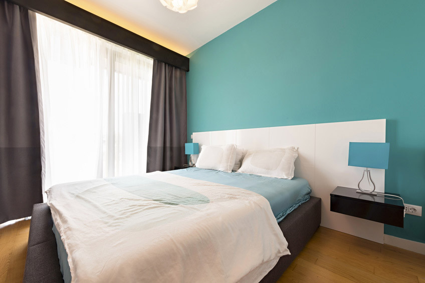 Bedroom with turquoise wall